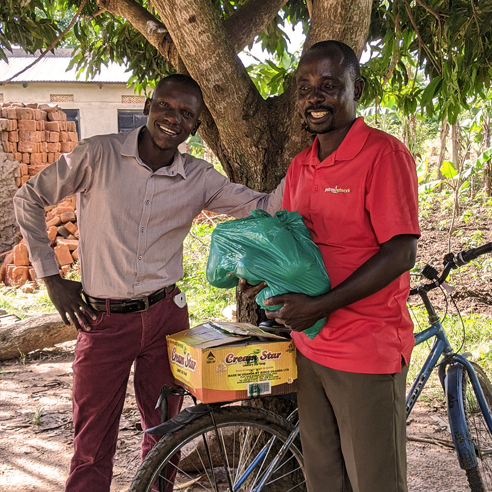 Pastor Silvest distributing soap through the villages of rural Uganda by motorcycle.